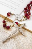 picture of inri  - Rosary beads on a book of psalms and sandstone background - JPG