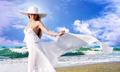 Young beautiful women in the white with pareo on the sunny tropical beach poster