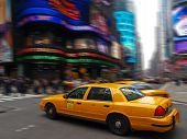 stock photo of new york night  - taxi in times square in New York City - JPG