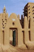 stock photo of dogon  - A vertical image of a mud mosque in a Dogon village in Mali - JPG