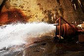 picture of gushing  - Water gushing from the back side of a dam - JPG