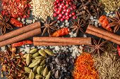 Aromatic Indian Spices On A Gray Slate Background. Herb And Spice Ingredients On Slate. Top View. Fo poster