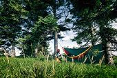 Camping In Woods With Hammock And Sleeping Bag On Mountain Biking Adventure Trip In Green Mountains. poster