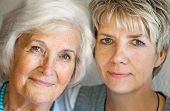 stock photo of beautiful woman face  - Senior woman and mature daughter portrait - JPG