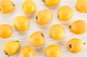 Fresh Orange Japanese Loquats Flatlay Isolated On Grey Wood Background poster