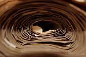 Paper Background. Abstract Paper Background. Cropped Shot Of Paper Roll. Craft Paper Folded In Roll. poster