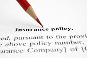 stock photo of insurance-policy  - Close up of pen on insurance policy