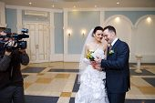stock photo of fiance  - Solemn registration of marriage in the Wedding Palace in Moscow - JPG