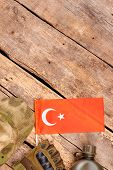 Equipment And Essentials Of Turkey Soldier With Copyspace. Wooden Desk Table With Copyspace. poster