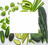 Green Vegetables And Herbs Assortment On A White Background With Blank Isolated Sheet For Your Text  poster