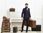 Luggage And Vacation Concept. Man, Traveller With Beard And Mustache With Luggage, Luxury White Inte poster