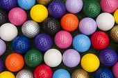 Variety Of Colorful Balls For Putt Putt Or Mini Golf poster