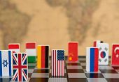 Symbols Of Countries On The Chessboard Against Against The Background The Political Map Of The World poster