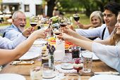 Garden Party Or Family Celebration Outside In The Backyard. People Sitting Around The Table, Clinkin poster