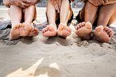 Senior friends enjoying the beach in the summertime poster