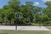 Basketball Playground In A Green City Park poster