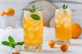 Fresh Summer Cocktail With Orange Juice And Ice Cubes. Glass Of Orange Soda Drink On Dark Background poster