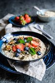 Bircher Muesli With Strawberries, Blueberries, Chia Seeds, Walnuts, Sunflower Seeds And Pumpkin Seed poster
