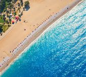 Aerial View Of Sandy Beach With Colorful Chaise-lounges And Blue Sea In Sunny Bright Day In Oludeniz poster
