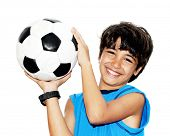 foto of preteens  - Cute boy playing football - JPG