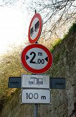 picture of campervan  - A road sign warns drivers of a two metre width restriction in one hundred metres  - JPG