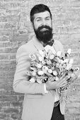 Spring Gift. Bearded Man Hipster With Flowers. Bearded Man With Tulip Bouquet. Flower For March 8. L poster