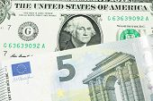 A Close Up Image Of A One American Dollar Note Close Up In Macro With Blue And Green Five Euro Bank  poster
