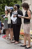 NEW YORK - JUNE 22: Speakers address an audience of supporters in Washington Square Park during the