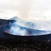 Crater Of Erupting Volcano. Red Hot Lava Flies From The Vent Of The Volcano poster