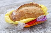 A Metaphoric Image Of A Sandwich Filled With Plastic Food poster