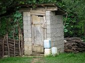 Rustic Wc. Rustic Outdoor Toilet Stands In The Garden. Rural Lifestyle, Latrine, Wc, Outhouse, Archi poster