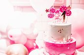Pink Cake With Pink Balloons For Birthday  On Pink Background. The First Day Of Birth. The Girl Or B poster