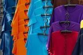 Colorful Clothes With Fashion Clothing Hang On Hanger In A Designer Store Or Shopping Mall For Sale. poster