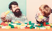 Dad And Kid Build Plastic Blocks. Child Care Development. Family Leisure. Father Son Game. Father An poster