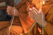 Buddhist Monk Praying Hand In Buddhism Tradition Ceremony. poster