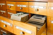 A File Cabinet Or Cabinet With An Open Drawer And Files. Database Concept. File Cabinet With Library poster