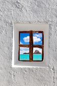 Ibiza Es vedra island view through whitewashed house window [ photo-illustration]