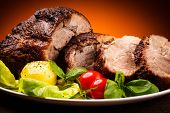 foto of bloody  - Roasted meat and vegetables - JPG