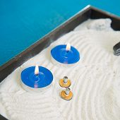 Zen little garden with blue candles and moxa for moxibustion acupunture poster