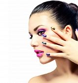 Fashion Beauty . Manicure and Make-up. Nail art. Beautiful Woman With Colorful Nails and Luxury Purp