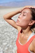 stock photo of drought  - Dehydration thirst concept woman in Death Valley desert - JPG