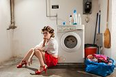 picture of laundry  - housewife bored in the laundry - JPG