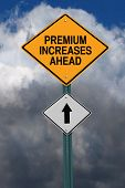 premium increases ahead road sign over dark blue sky with clouds