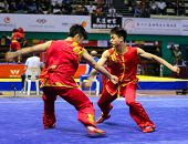 KUALA LUMPUR - NOV 05: Members of Macau's dalian team performs a fight scene in the Men's Dual Event
