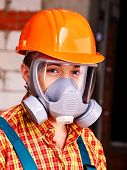 Man in builder  respirator indoor.