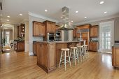 pic of granite  - Kitchen in luxury home with wood and granite island - JPG