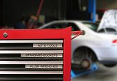 picture of auto repair shop  - tool cabinet with car in the background - JPG