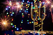 stock photo of explosion  - Champagne glasses with fireworks on background - JPG