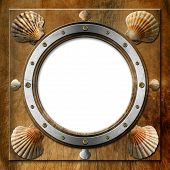picture of scallop-shell  - Brown and metallic porthole with bolts and eight scallop shells - JPG