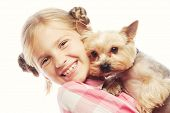 stock photo of yorkshire terrier  - Portrait of an adorable young girl smiling holding Yorkshire Terrier puppy - JPG
